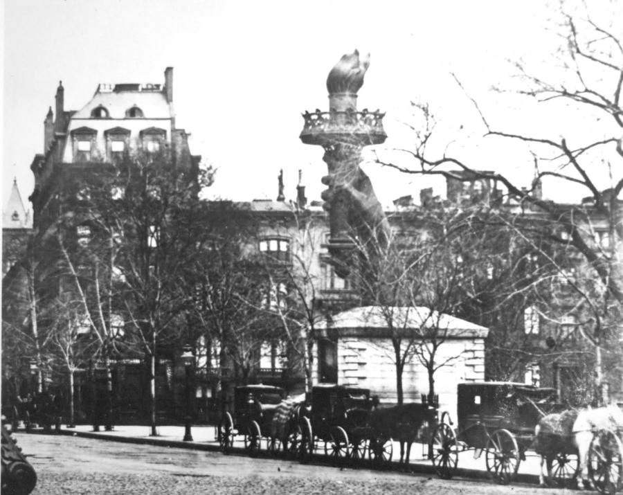 Lady Liberty's arm in Central Park, circa 1876. The arm was place in the park for years as a fundraising effort to build a base to support the statue, with little success. Joseph Pullitzer requested donations from his readers and in less than five months, after over 120,000 donataions, he'd raised the money needed.